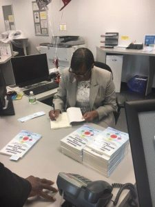 Dr. Taylor signing books 2