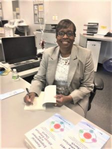 Dr. Taylor signing books